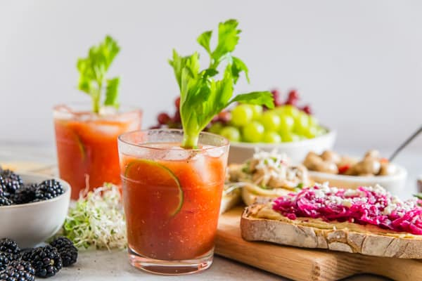 This horseradish bloody mary is slightly spicy, packed full of flavor and the perfect addition to any party or this tasty hummus toast brunch spread. Plus it's ready in just 5 minutes so it's the perfect party cocktail!
