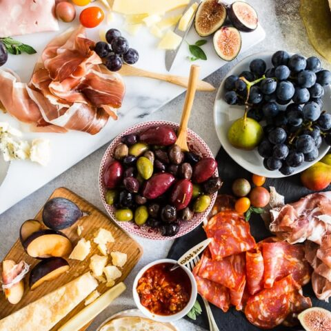 Ultimate Italian Antipasto Platter laid out on a white marble board