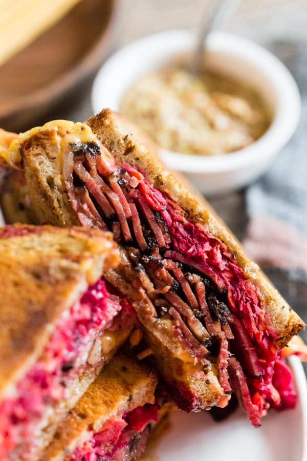 This grilled pastrami root vegetable slaw sandwich is the perfect autumn sandwich. It's grilled until the outside is crispy and the inside is perfectly warmed through. Plus, the addition of a homemade root vegetable slaw takes this sandwich to a whole new level of deliciousness.