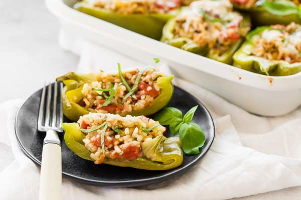 sliced in half ground chicken stuffed bell peppers