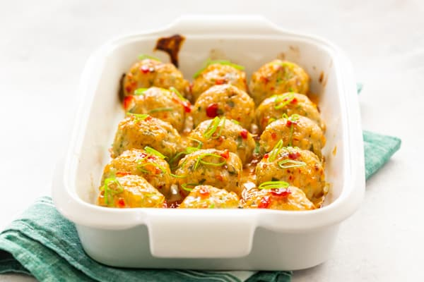 easy thai baked chicken meatballs in a white casserole dish