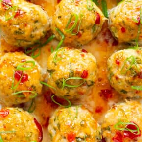 easy thai baked chicken meatballs sprinkled with green onions