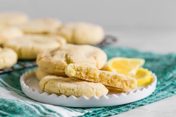vanilla bean lemon sugar cookie broken in half on a plate