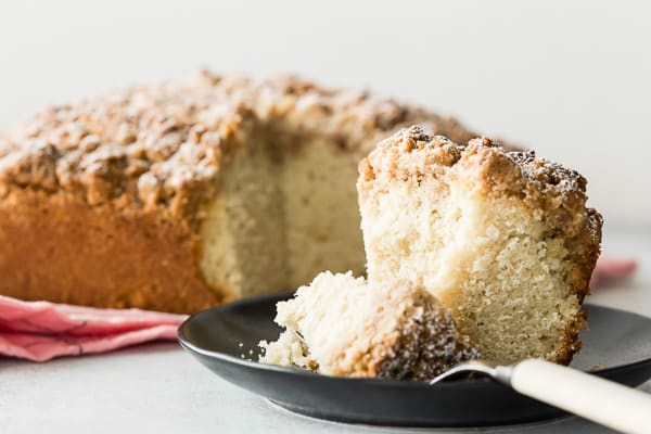 sourdough discard cinnamon crumb cake sliced with a bite sitting on a fork