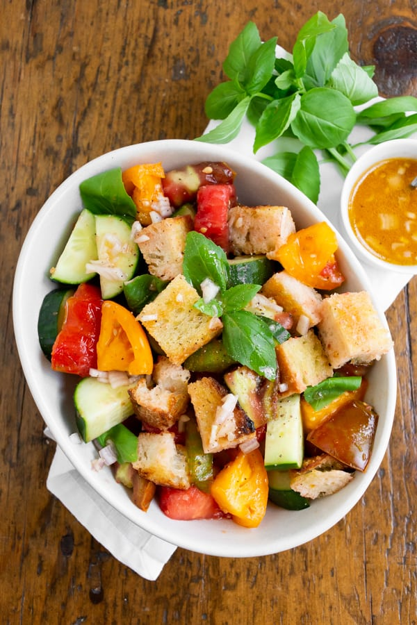 grilled sourdough panzanella salad with tomato water dressing