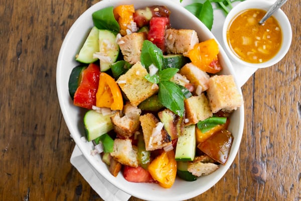 grilled sourdough panzanella salad with tomatoes in a bowl