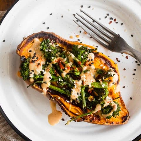 broccoli rabe and hummus stuffed overhead shot of sweet potatoes on a plate