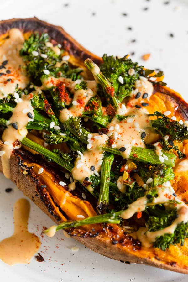 close up shot of broccoli rabe and hummus stuffed sweet potatoes on a plate