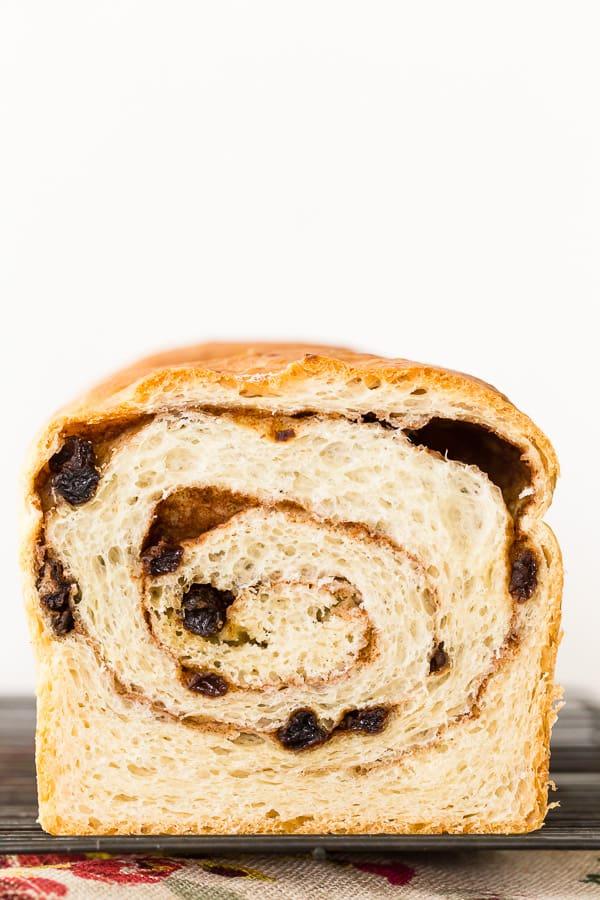 cinnamon raisin sourdough bread cut in half with the swirl showing