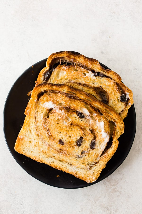 cinnamon raisin sourdough bread sliced and toasted with butter