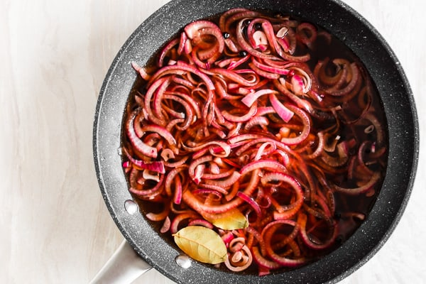 overhead shot of quick and easy pickled red onions in a pan