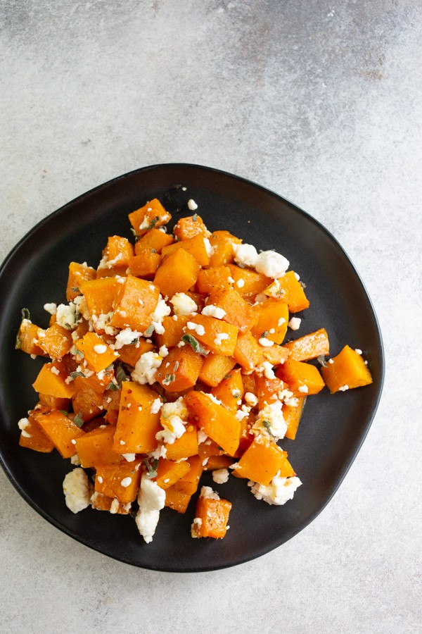 honey roasted butternut squash served on a black plate