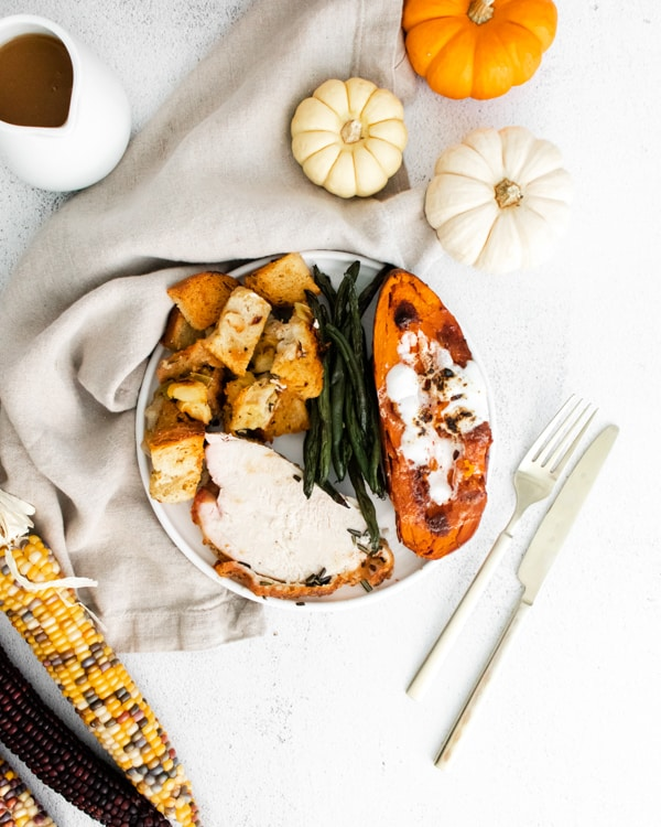 sheet pan thanksgiving dinner plated with fall decor