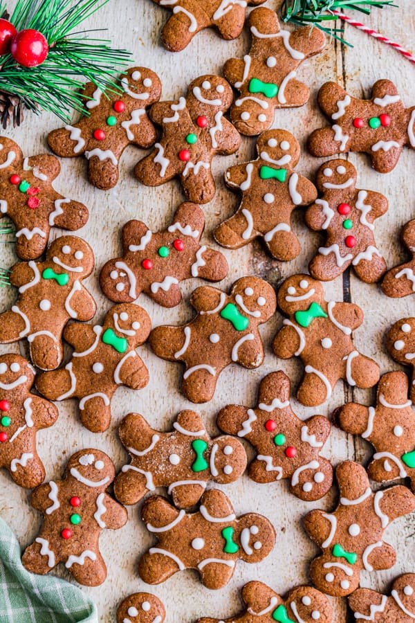soft gingerbread cutout cookies laid out on a board