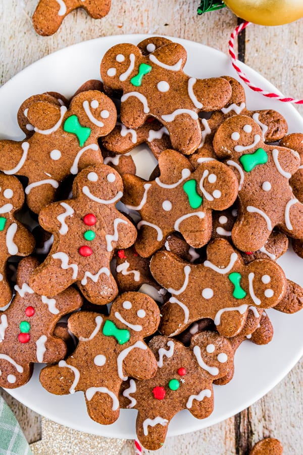 soft gingerbread cutout cookies on a white plate