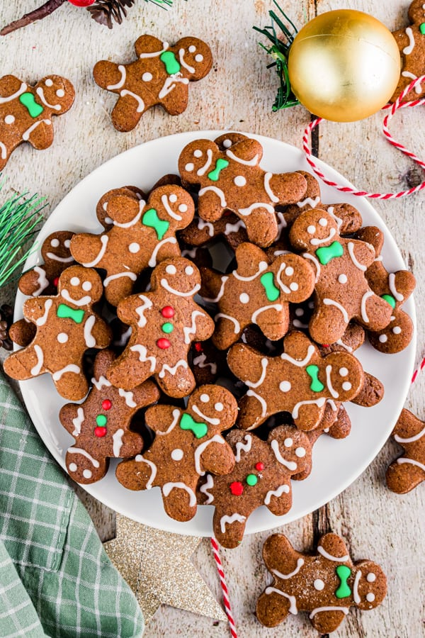 Soft gingerbread cutout cookies on a white plate with green napkin