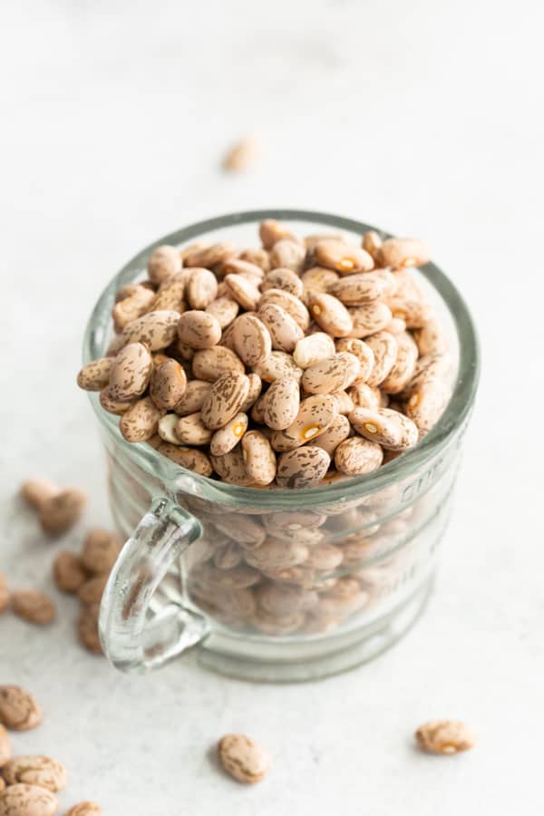 Dried pinto beans in a cup