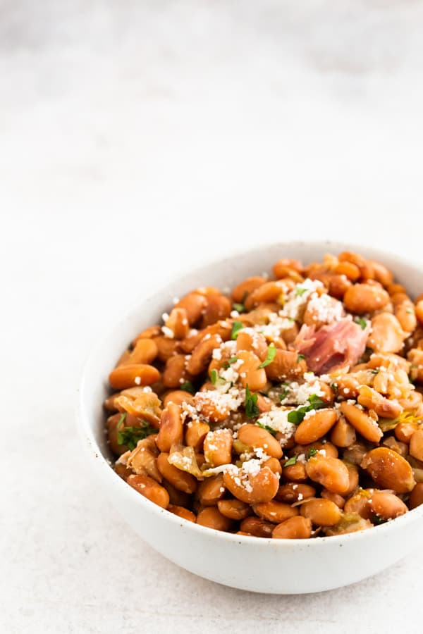 Instant Pot pinto beans in a white ceramic bowl