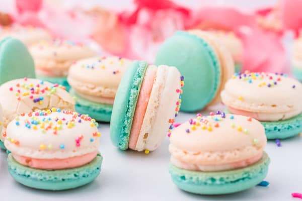 Birthday cake macarons on a marble decor board