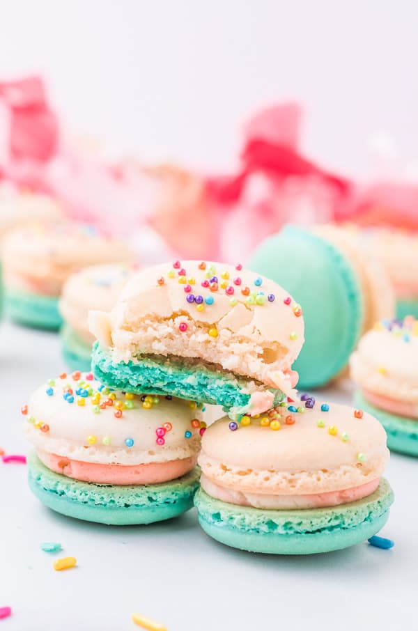 birthday cake macarons with a bite taken out of it