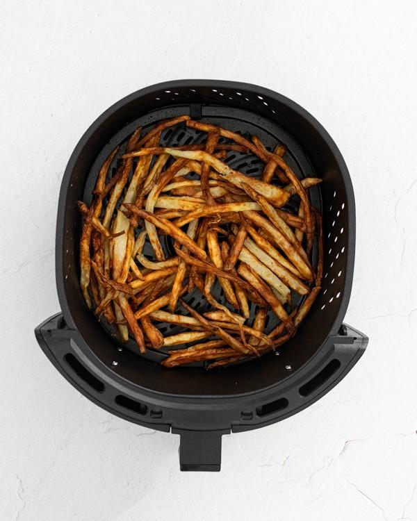 Garlic Parmesan Air Fryer French Fries inside the air fryer basket
