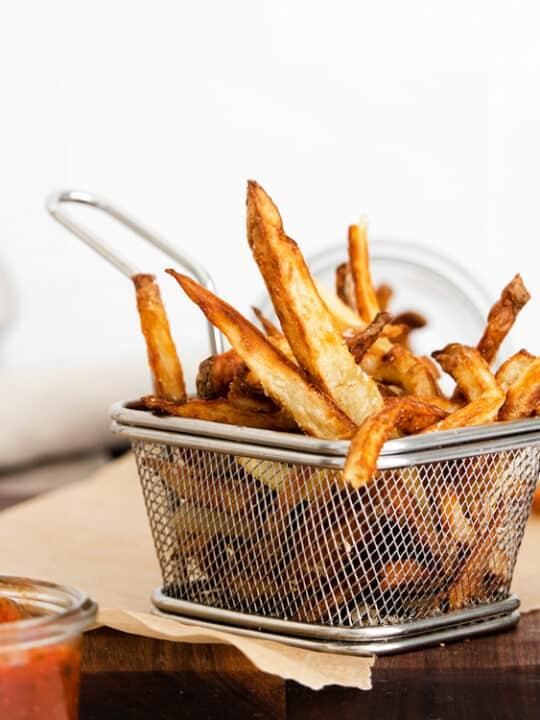 Garlic Parmesan Air Fryer French Fries in a metal basket