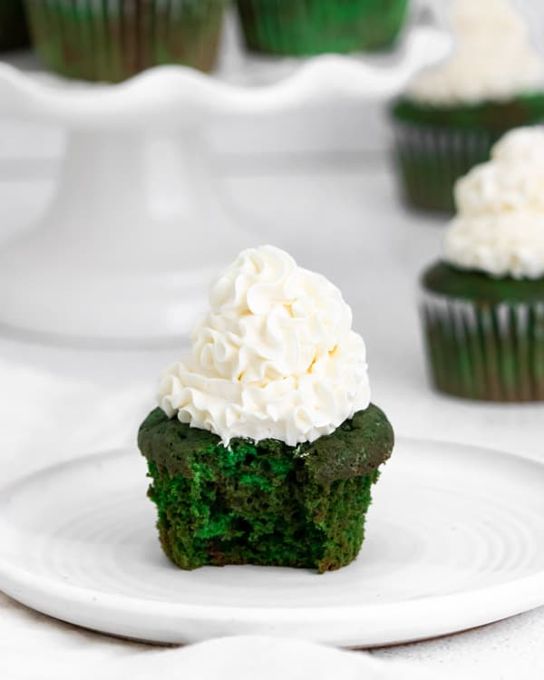 Green velvet cupcakes with a bite taken out of it