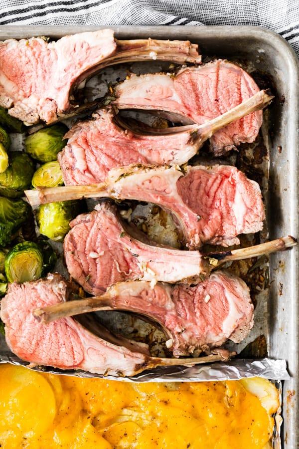 rare roasted lamb chop on a sheet pan.