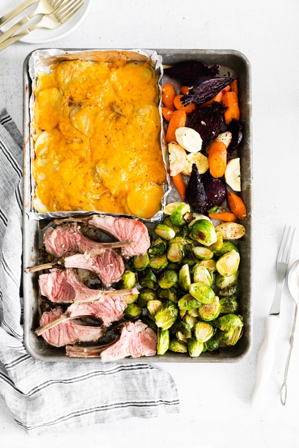 cooked sheet pan easter dinner with carved lamb chops.