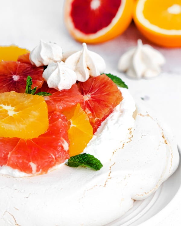 winter citrus fruits on top of a pavlova