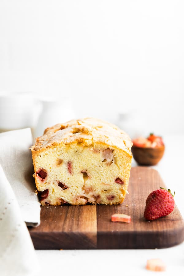 strawberry rhubarb pound cake showing the cut side to see the fresh fruit.
