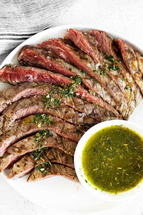 sliced grilled chimichurri flank steak.