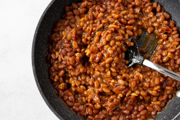 easy bacon baked beans cooked in a skillet.