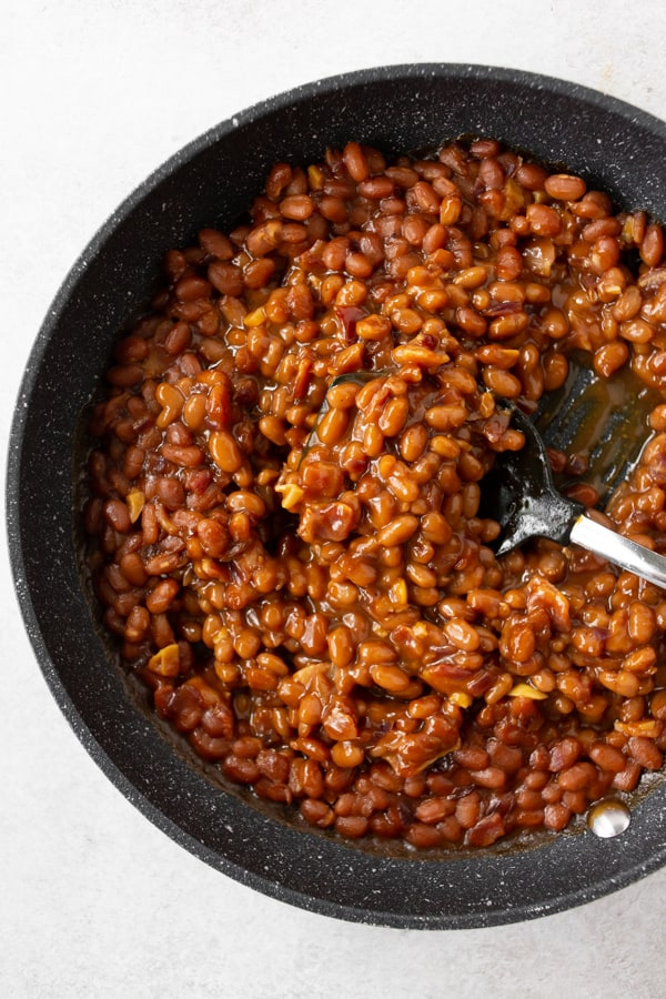easy bacon baked beans in a skillet.