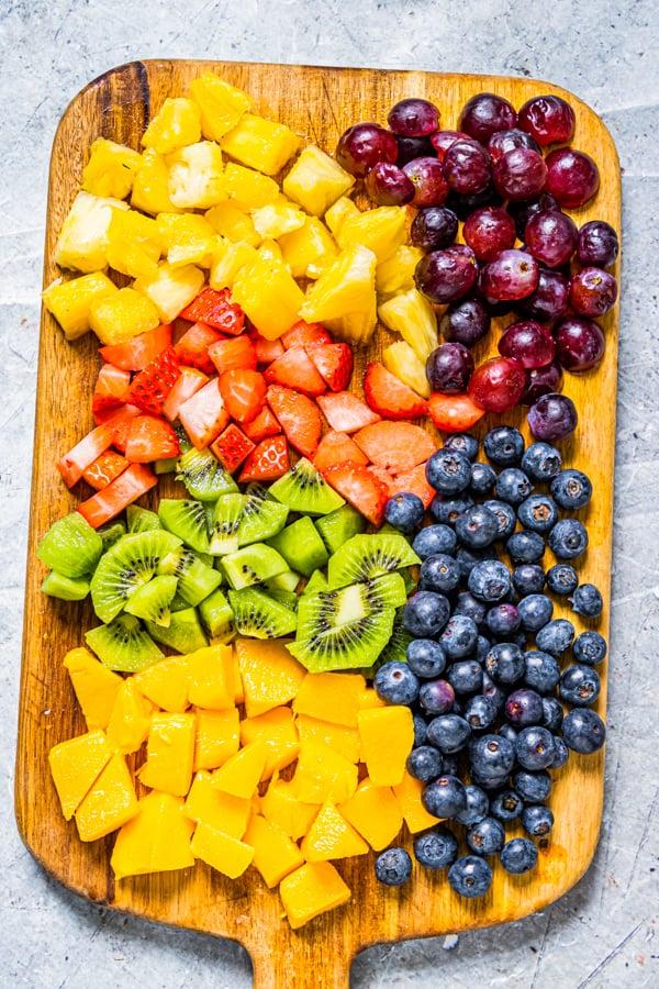 chopped fruit on a cutting board.