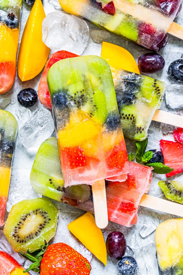 close up of rainbow fruit popsicle.