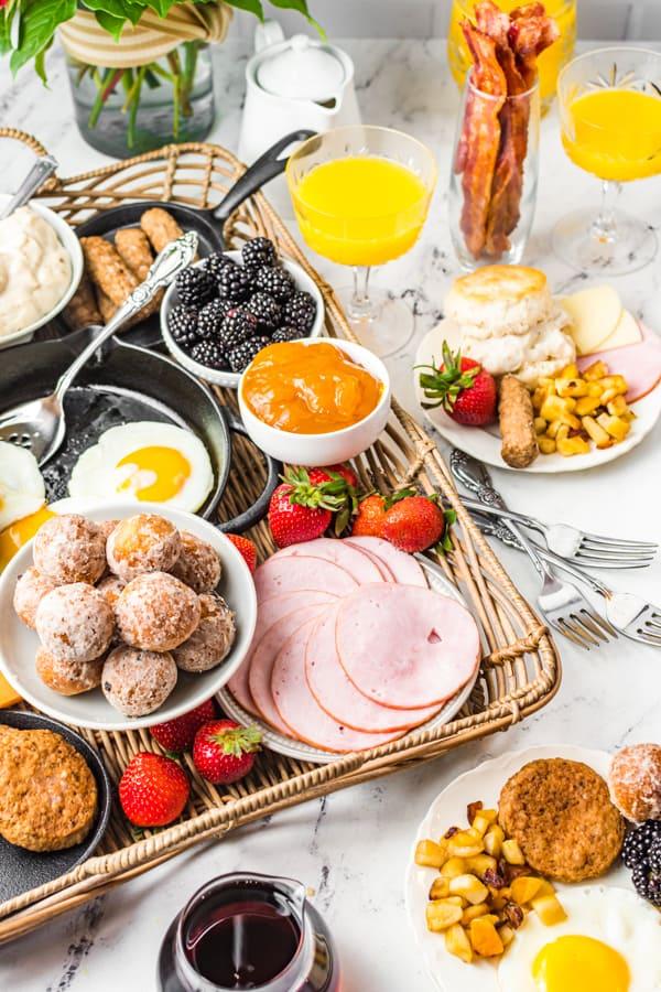 Breakfast Charcuterie Board sitting on a wicker serving stray.