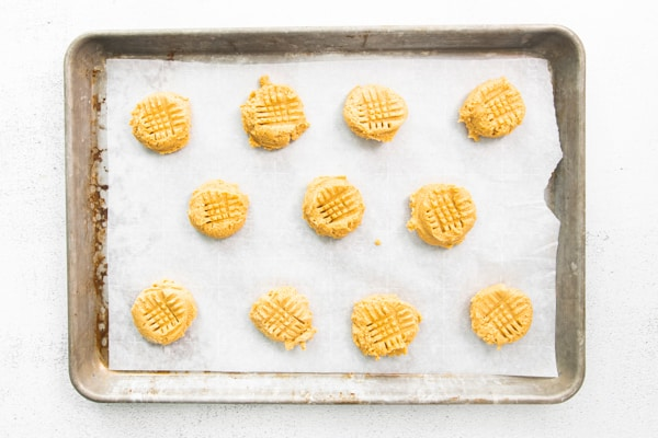 Brown Butter Peanut Butter Cookies uncooked on a sheet pan.