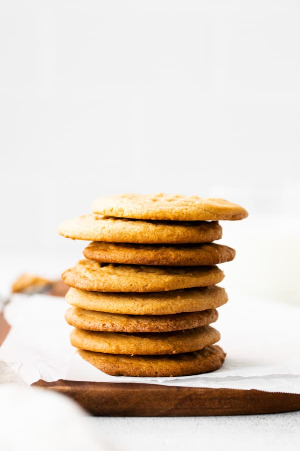 Brown Butter Peanut Butter Cookies stacked up on a serving platter.