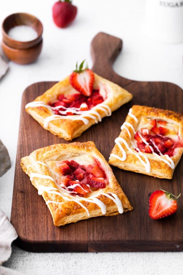 easy strawberry cheesecake Danish drizzled with glaze.