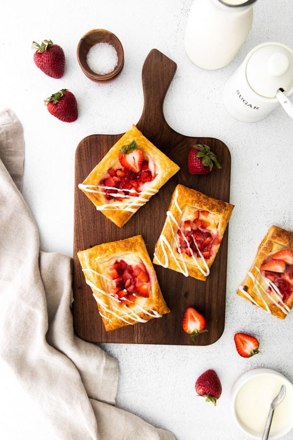 easy strawberry cheesecake Danish sitting on a cutting board.