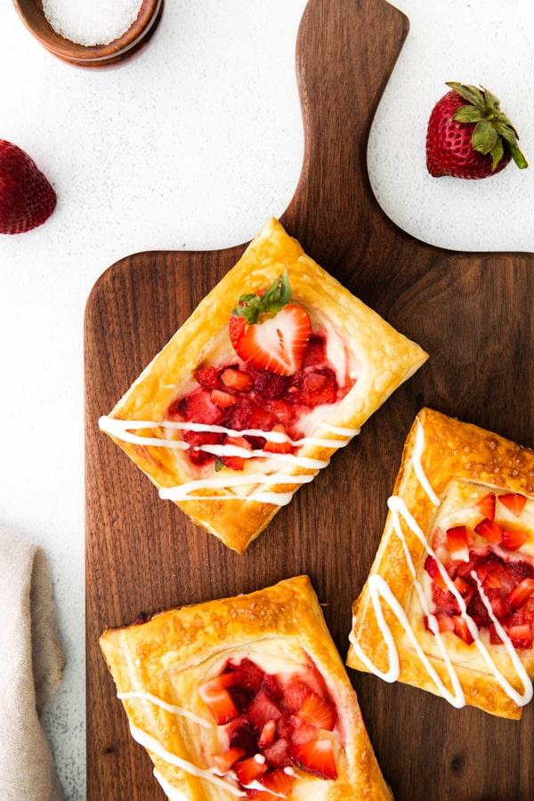 easy strawberry cheesecake Danish garnished with fresh berries.
