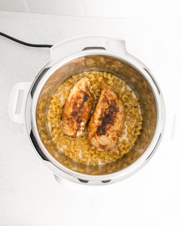 Ingredients for Instant Pot Cajun Chicken Alfredo inside the Instant Pot.