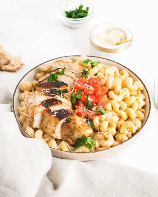 Instant Pot Cajun Chicken Alfredo served in a ceramic bowl.