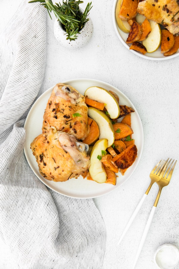 Sheet Pan Chicken and Apples served on white plates.