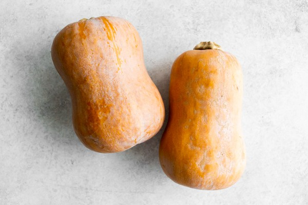 two honeynut squash laying on a table.