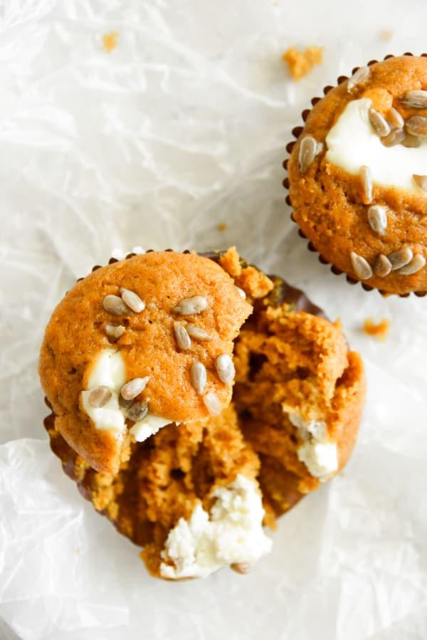 Pumpkin Cream Cheese Muffins broken in half.